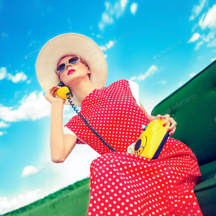 fashion portrait of a girl in a retro style with a phone