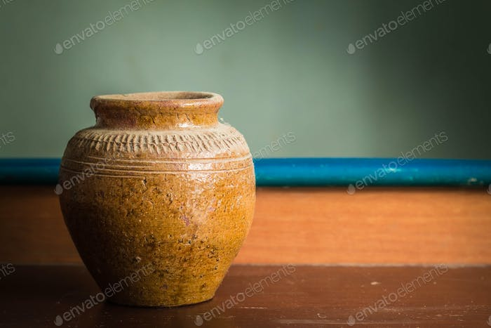 Old jar on a wooden