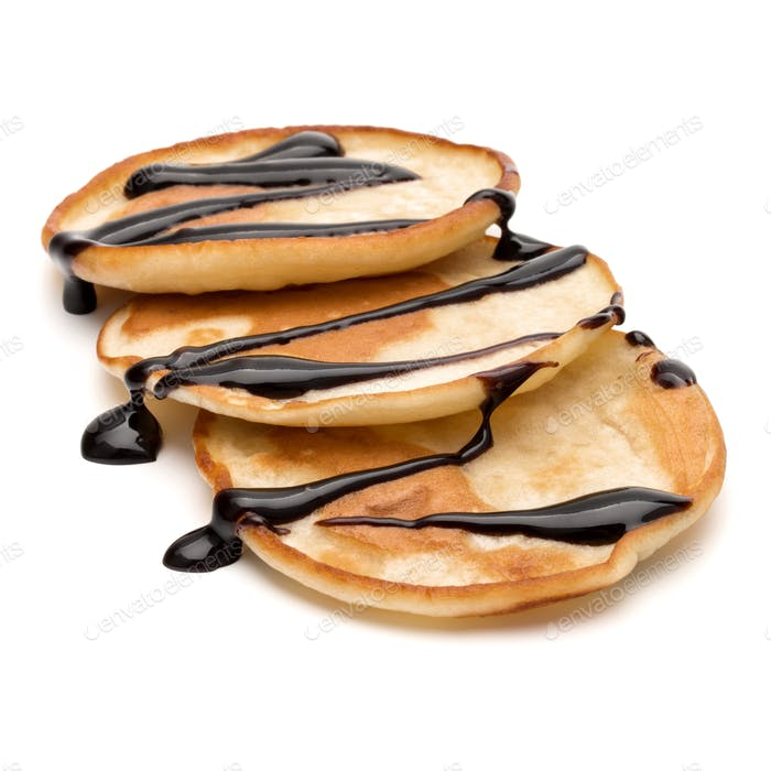Three pancakes with chocolate syrup isolated on white background cutout.