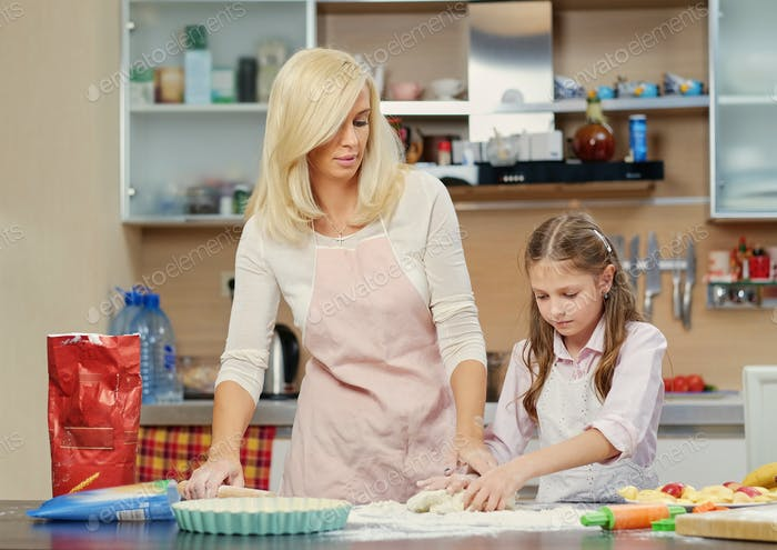 Mother and daughter prepare the dough.