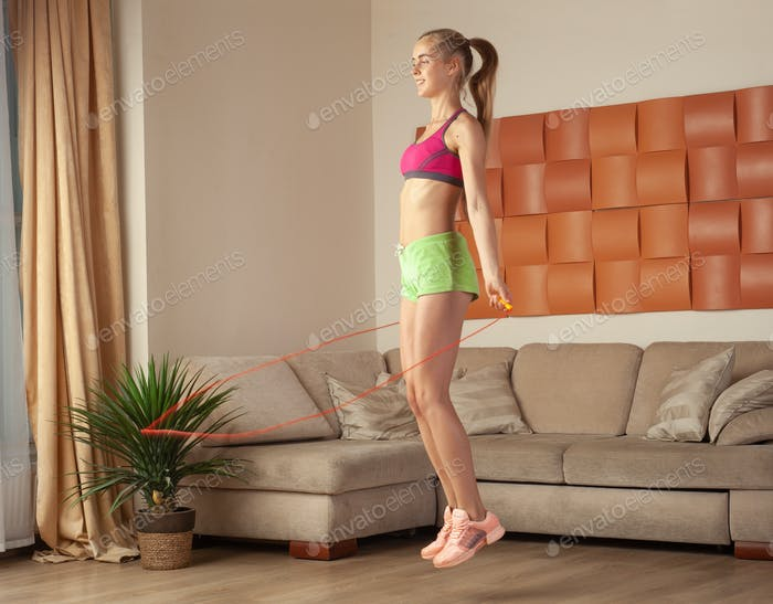 fit woman doing fitness exercise at home