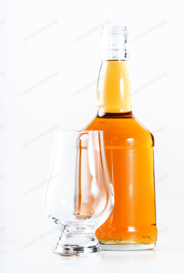 Scotch Whiskey without ice empty glass, white background, copy space