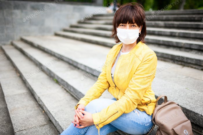 Pretty youthful middle-aged woman in white medical mask