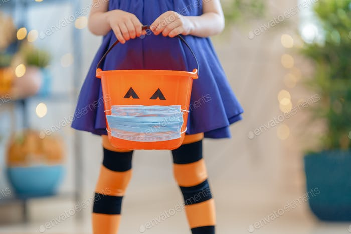 kid with a basket for sweets