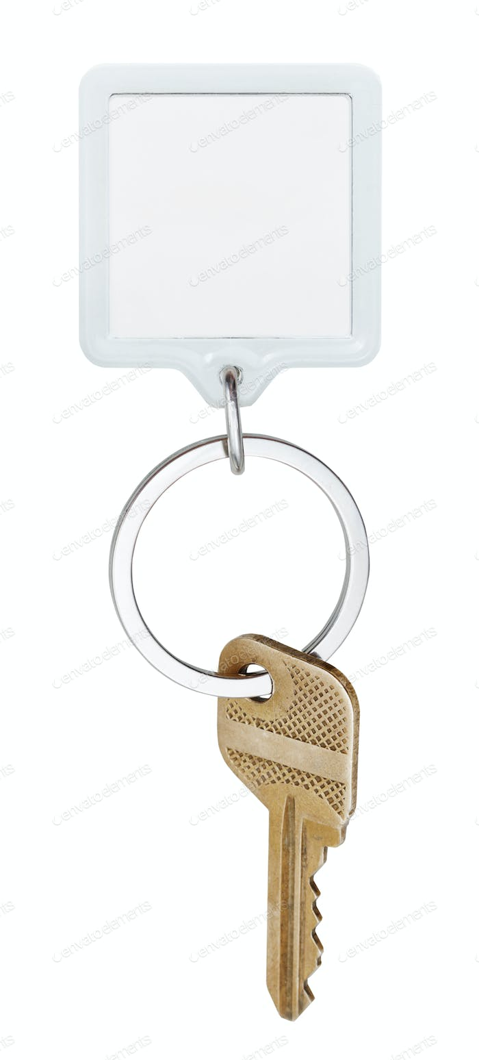 door brass key and square keychain on ring