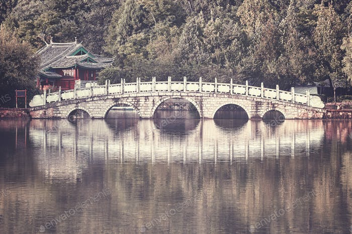 Retro toned picture of Suocui Bridge, Lijiang, China.
