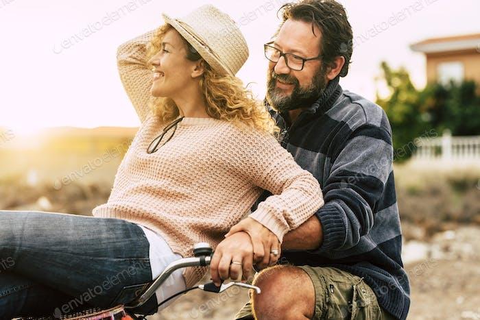 Happy youthful couple enjoy the bike ride together