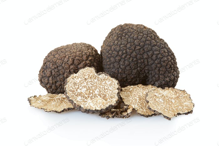 Black truffles group and slices on white, clipping path