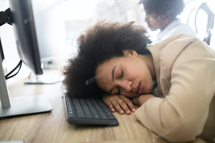 Portrait of an exhausted business woman sleeping at work
