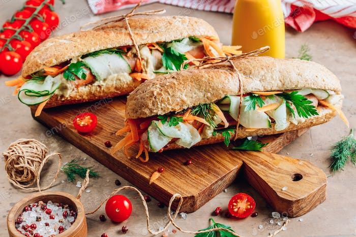 Hot dog with carrots, cucumber, herbs and mustard