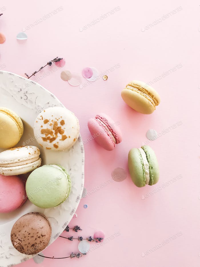 Delicious pink and green macaroons on pink paper