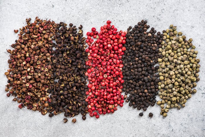 Five pepper colors and varieties background