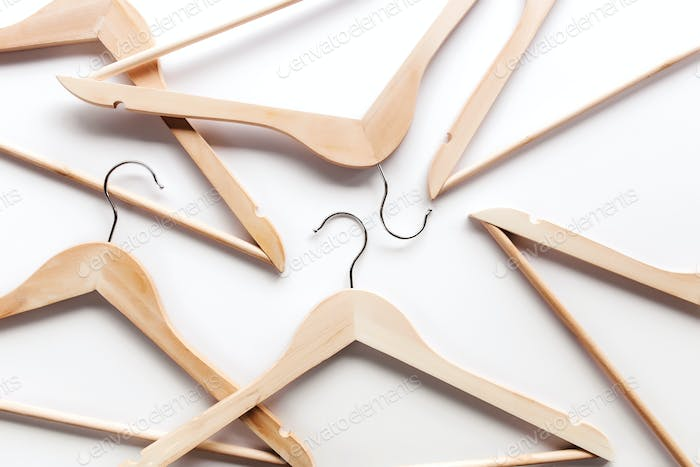 Black Friday, clothing industry concept on white background with wooden hangers
