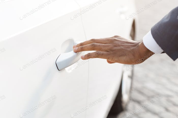 Opening his new car. Male hand touching car handle
