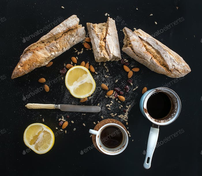 Rustic breakfast set of french baguette broken into pieces, grapefruit, sunflower seeds