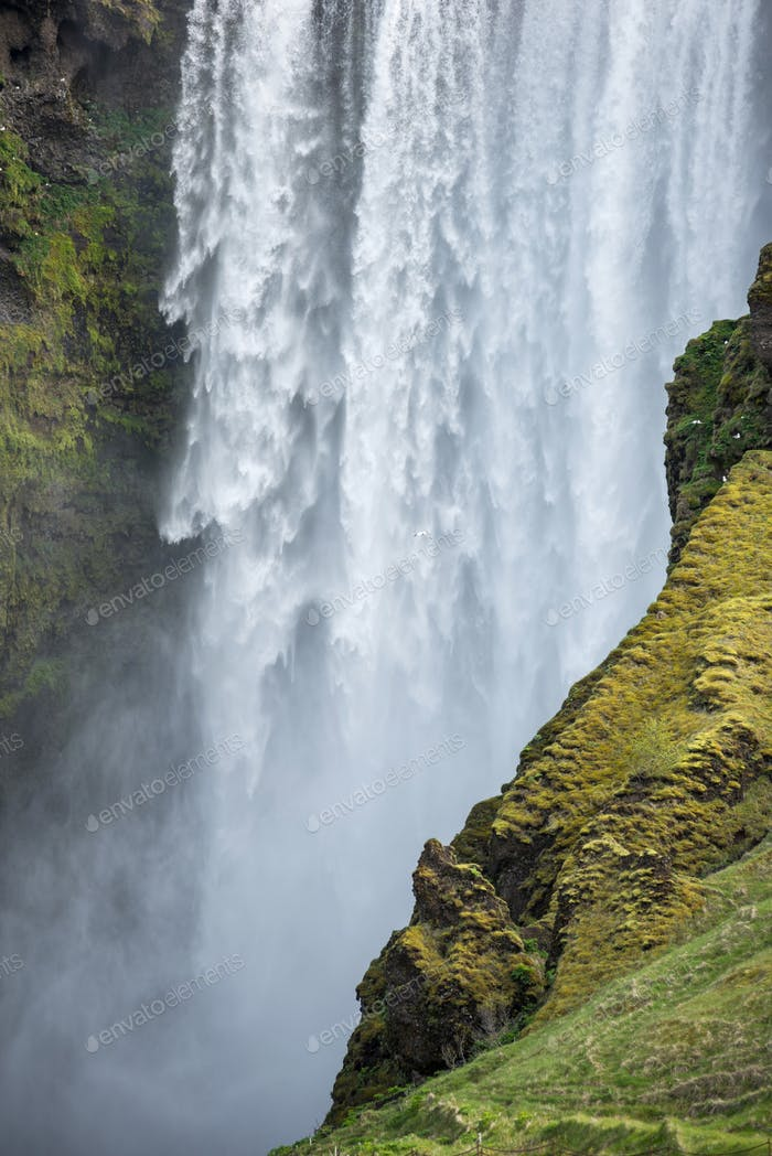 Skogafoss waterfall in Southern Iceland, is one of country's most epic tourist destinations