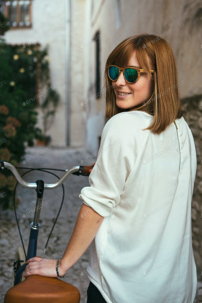 Trendy female on bike