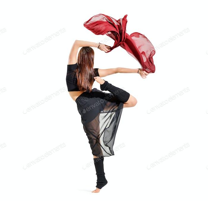 Woman performing an alternative arabesque dance pose