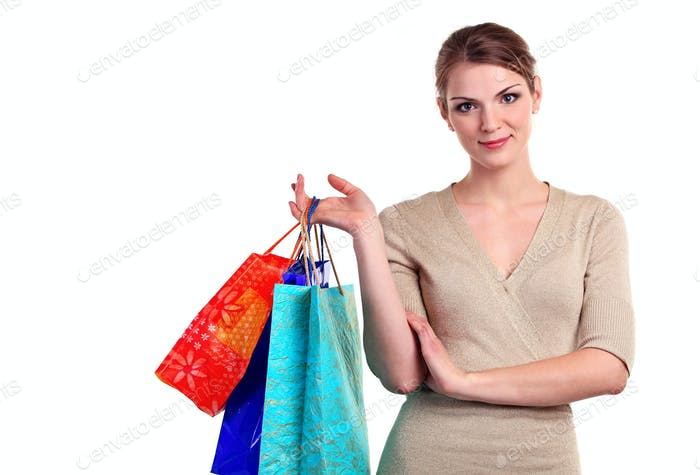 Portrait of a pretty young woman with shopping bags