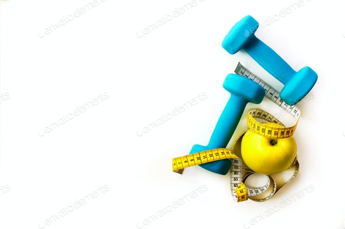 Fitness concept. Turquoise dumbbells, yellow measuring tape and fresh apple. Diet, sport, healthy