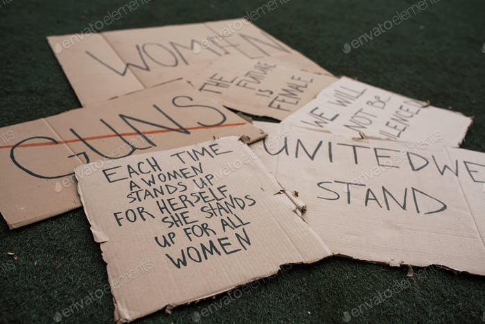 Messages for the people. Group of banners with different feminist quotes lying on the ground