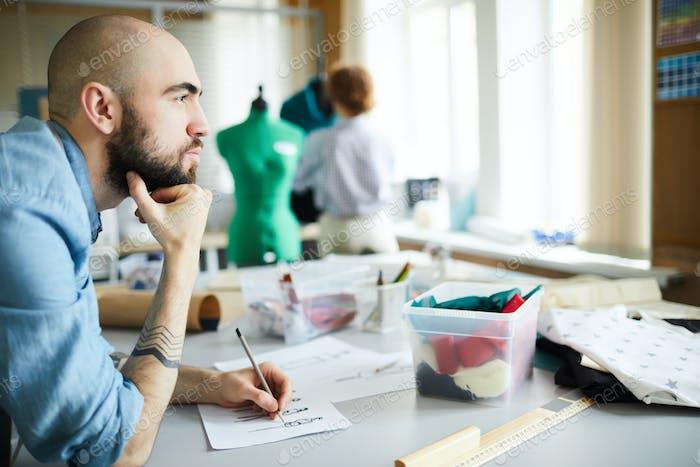 Pensive tailor