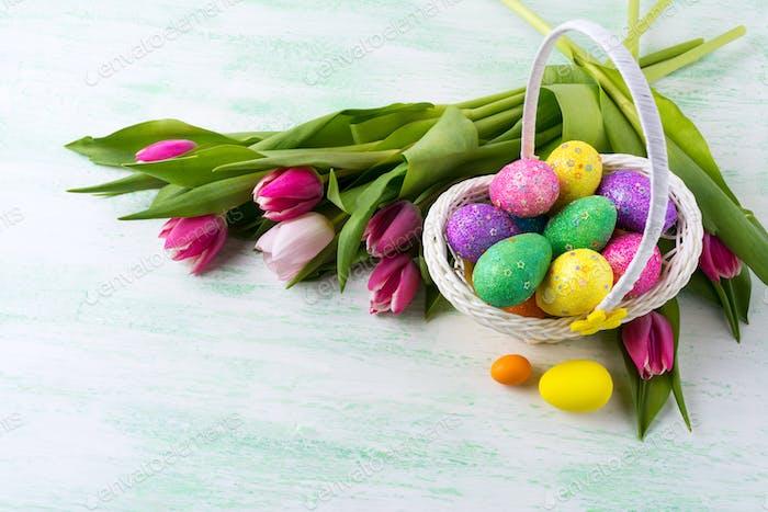 Easter star decorated glitter eggs in yellow wicker basket backg