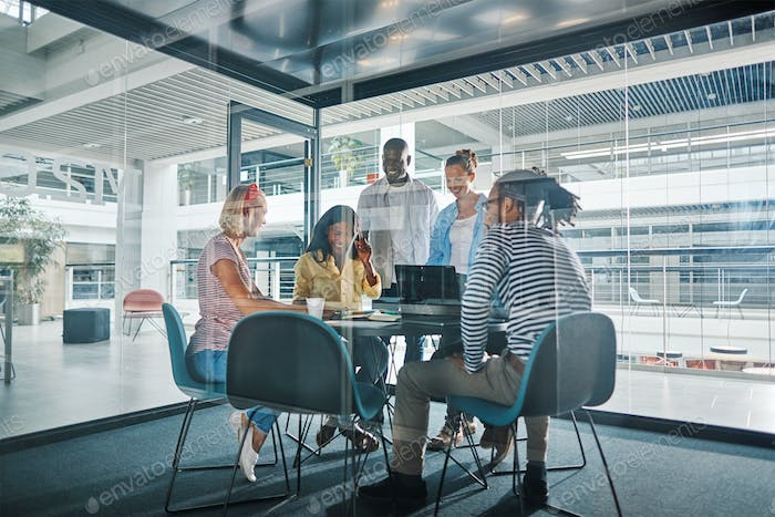 Diverse businesspeople working around a table in an office boardroom