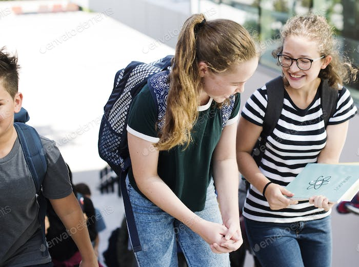 Students walking and talking togetherness
