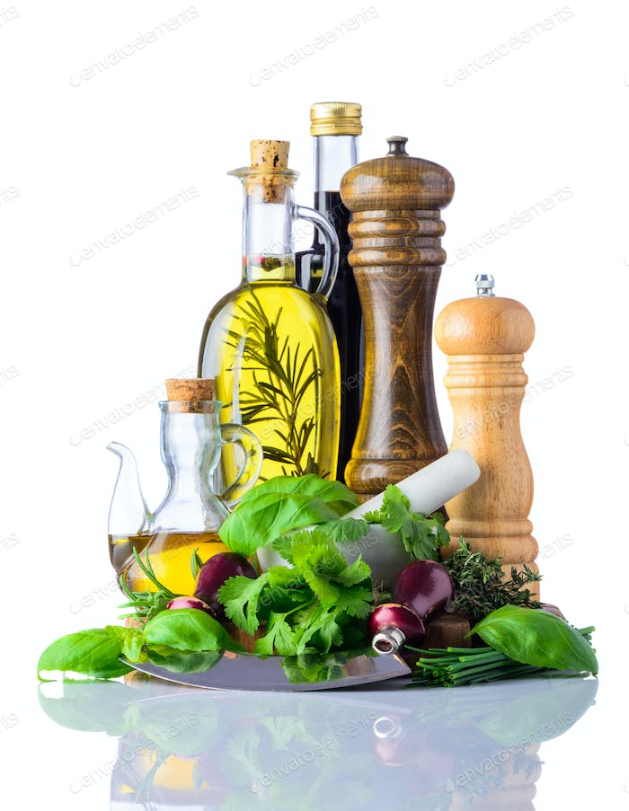 Cooking Oil and Green Herbs Food Seasoning on White
