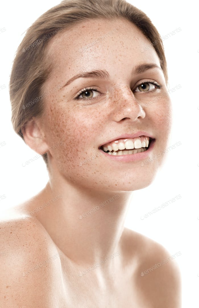 Woman freckle happy young beautiful studio portrait with healthy skin
