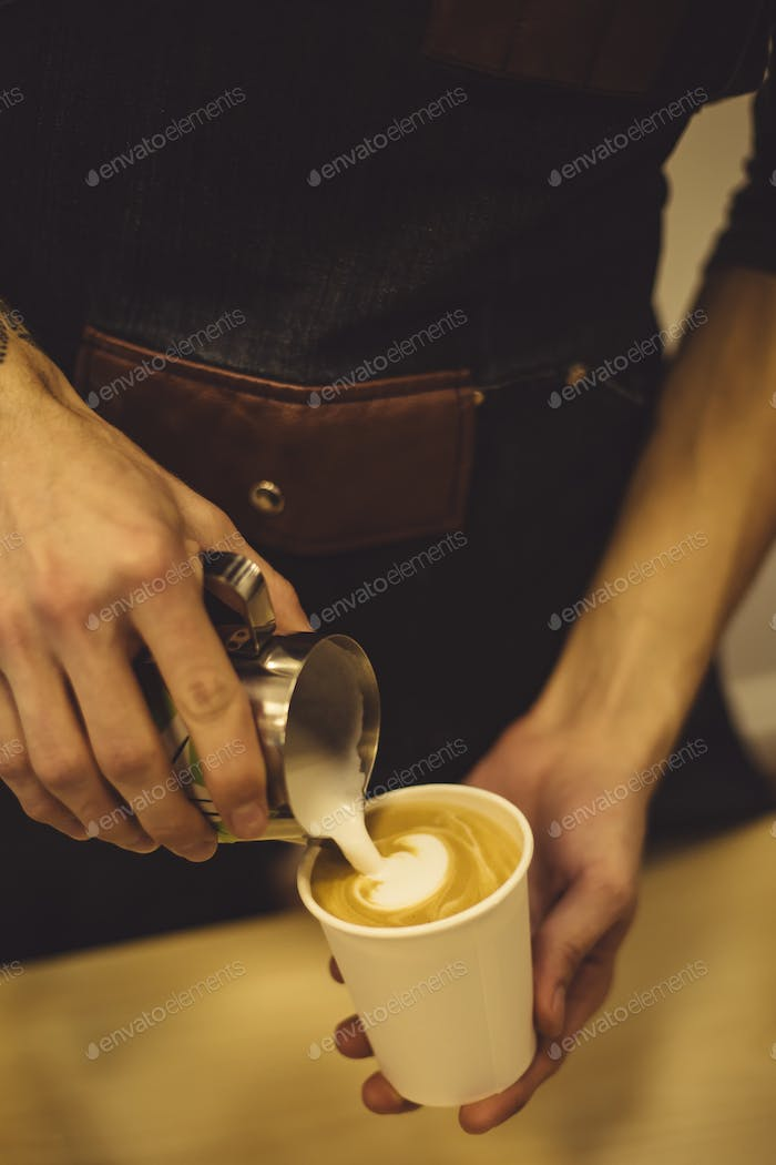 Bartender pouring coffee to cup