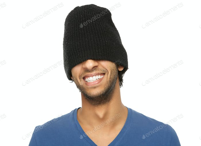 Man laughing with black hat covering eyes