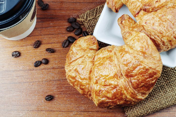 croissants and coffee on wooden