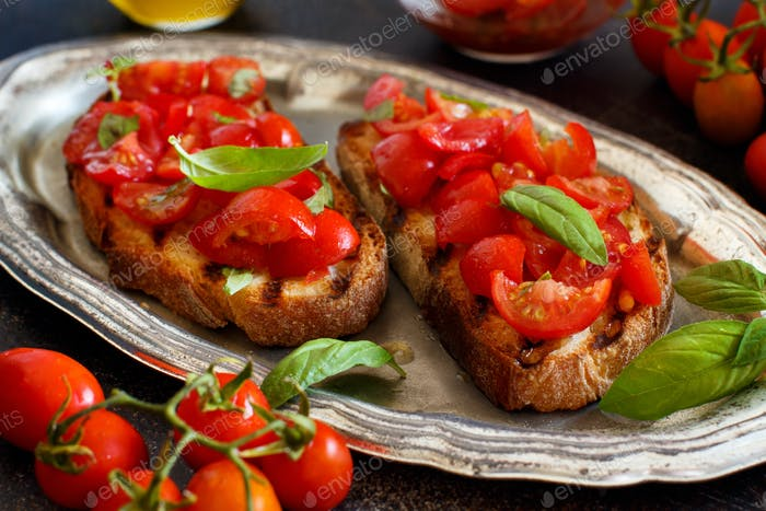 Homemade Italian Bruschetta Appetizer with cherry tomatoes and basil