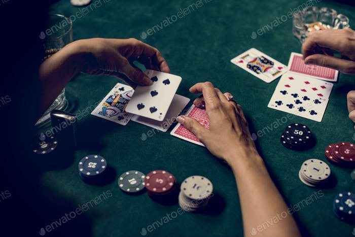Hands holding card on gambling game