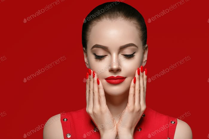 Beautiful curle hair female in red with red lips and dress manicure, beauty rose afro.