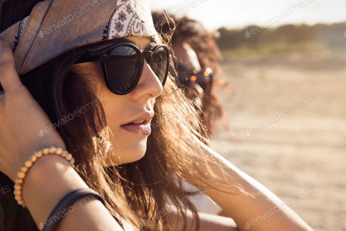 Close up of a young woman in sunglasses
