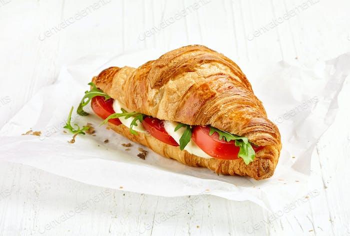 croissant sandwich with tomato and mozzarella