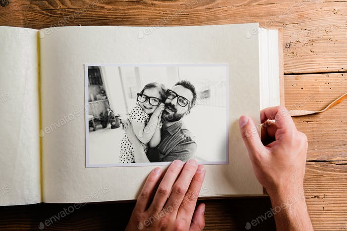 Fathers day concept. Photo album, black-and-white pictures.