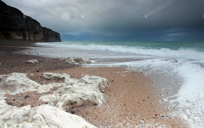 stormy clouds over ocean coast with rocks