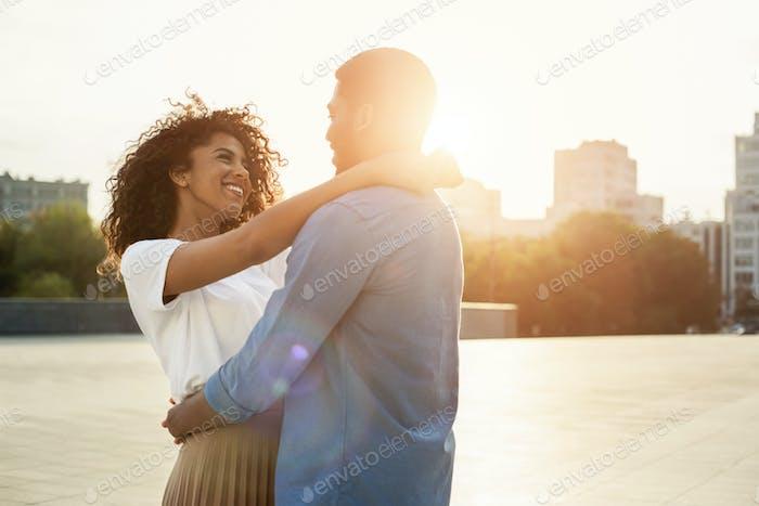 Couple cuddling, enjoy walk in the city