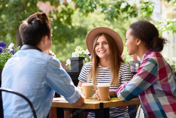Students Chatting at Lunch in Cafe Outdoors