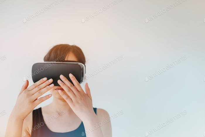 Young woman wearing virtual reality goggle