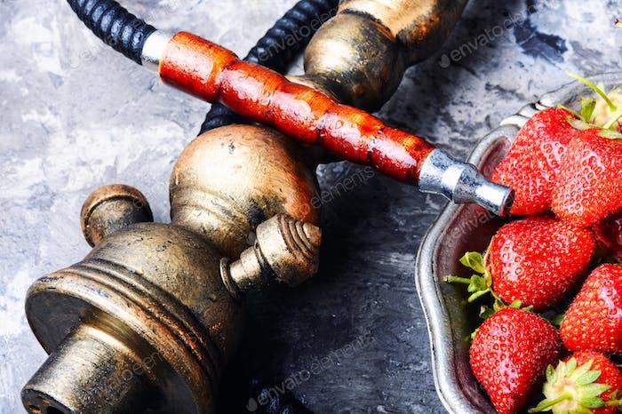 Stylish oriental shisha with strawberry