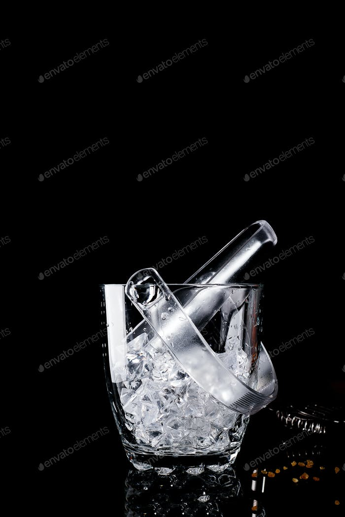 Glass ice bucket isolated on black