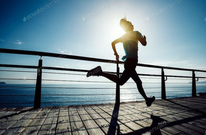 Running on seaside coast boardwalk