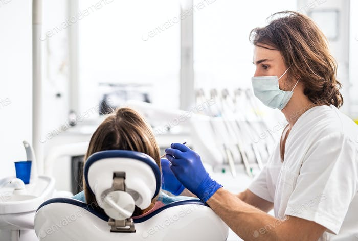 A dental check-up of patient in dentist surgery