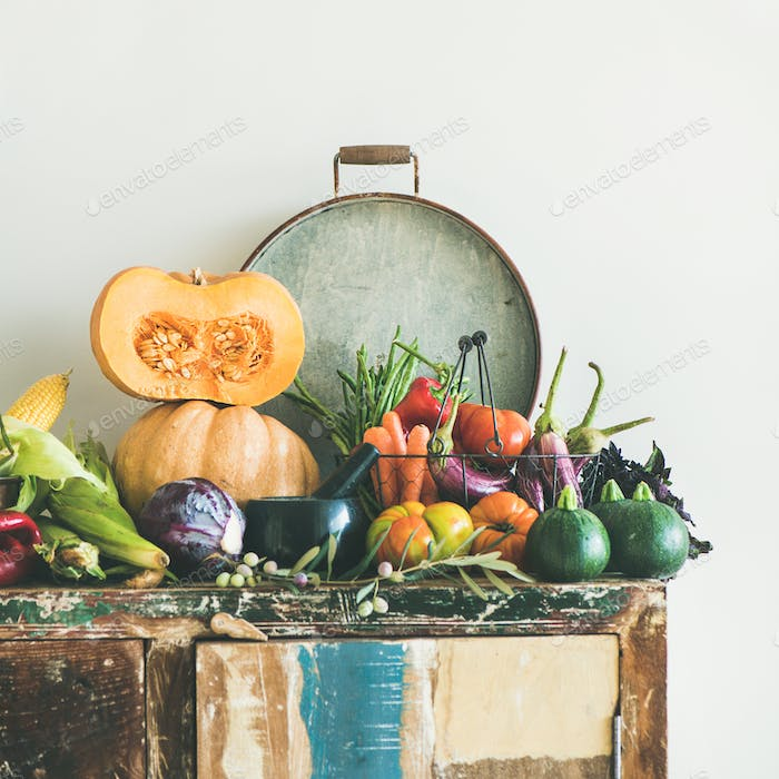 Fall vegetarian food ingredients variety on rustic cupboard, square crop
