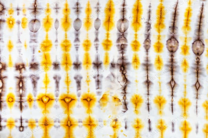 abstract yellow and brown decor in tie-dye batik